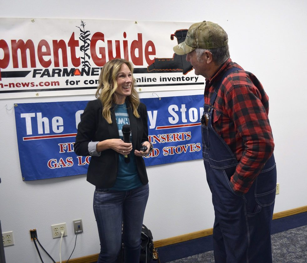 -Messenger photo by Kriss Nelson  Marji Guyler-Alaniz, founder and president of FarmHer, speaks with Kenneth Ropte, of Humboldt, after her presentation at the Farm News Ag Show Wednesday. Guyler-Alaniz shared her story of how FarmHer started and how it is helping to shine a light on women in agriculture.