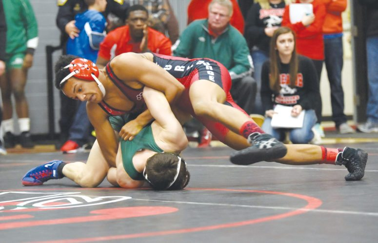 -Messenger photo by Britt Kudla  Drevon Ross of Fort Dodge wrestles against Storm Lakes Alonzo Rios during Class 3A District on Saturday