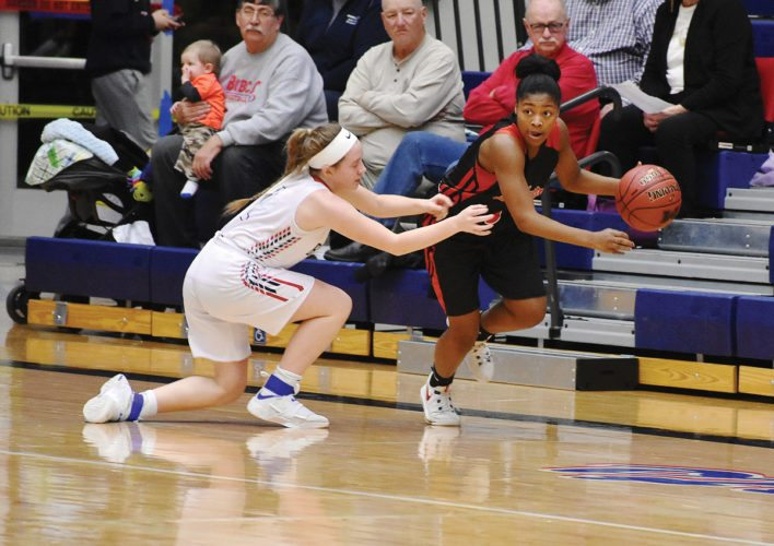 Photo by Thorn Compton, for The Messenger  Shareece Smith drives for Fort Dodge at Marshalltown on Friday.