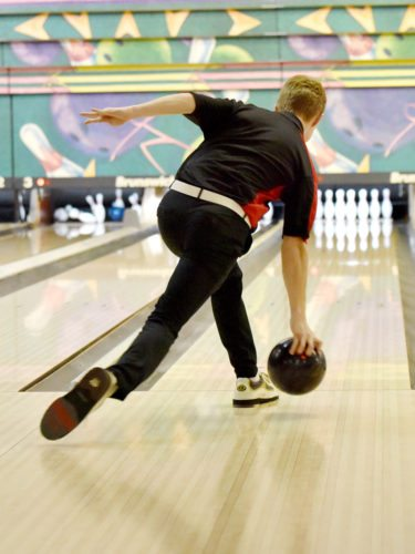 Messenger photo by Britt Kudla  Jared Jacobson of Fort Dodge bowls against Dowling on Thursday at Ridgewood Lanes. For more photos, please visit CU.messengernews.net