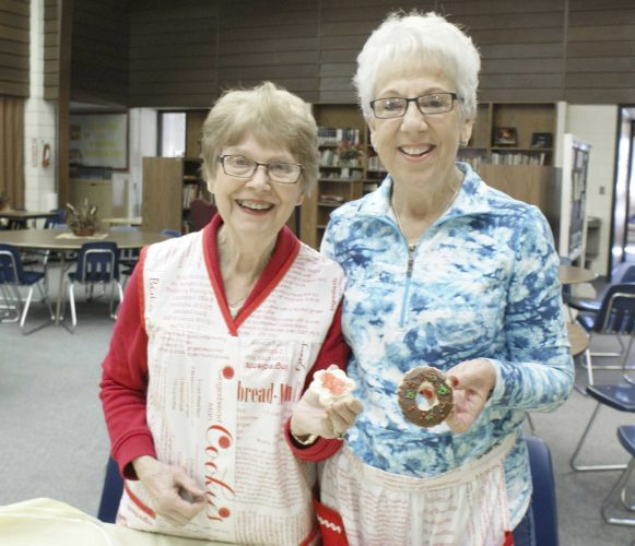 -Messenger photo by Dawn Bliss  KARENDEWINTER, left, and Phyllis Michaelson say the act of giving cookies as holiday gifts carries a more personal meaning because of the time and effort they require.