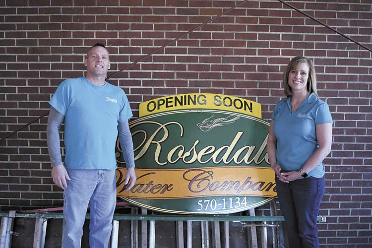 -Messenger photo by Peter Kaspari  John Miles, who handles operations for Rosedale Water Store, and owner Jana Riley pose next to the store's sign. The Rosedale Water Store and Rosedale Water Company are expected to open in mid-January in Fort Dodge.