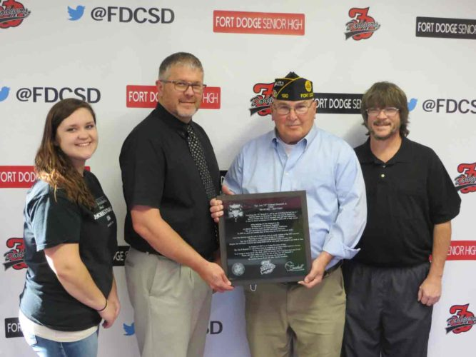 "The Fort Dodge Veterans Council and the Mid-Iowa Detachment of the Marine Corps League presented a plaque to Fort Dodge Senior High in honor of Sgt. Jon ""JJ"" Bonnell Jr.'s service. JJ was killed in Iraq in August of 2007 when he stepped on an improvised explosive device. Bonnell was a FDSH alum and member of the Dodger baseball team. The plaque will be hung in the high school cafeteria just outside one of the entrances to the main gym. Pictured are: Sarah Bonnell, JJ Bonnell's sister; Kenneth Hayes, FDSH principal; Tom Dorsey from the Fort Dodge Veterans Council; and Jon Bonnell Sr., JJ Bonnell's father."