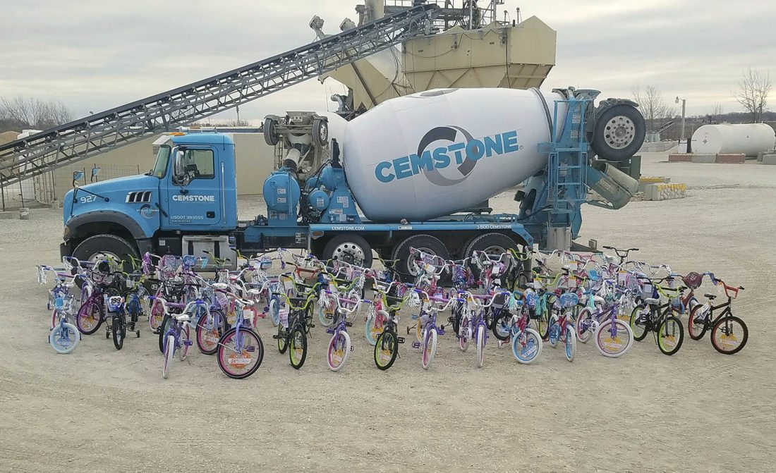 -Submitted photo   Bikes for Tykes are displayed at Cemstone Cement after employees and their families spent Saturday morning assembling them for donation to less fortunate families. There were 67 bikes donated from the company, which were taken to Fort Dodge Ford Toyota where between 250 and 350 are currently stored.