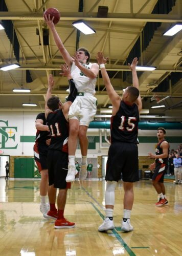 -Messenger photo by Britt Kudla Will Woodruff of St. Edmond shoots over Clarion-Goldfield/Dows on Friday