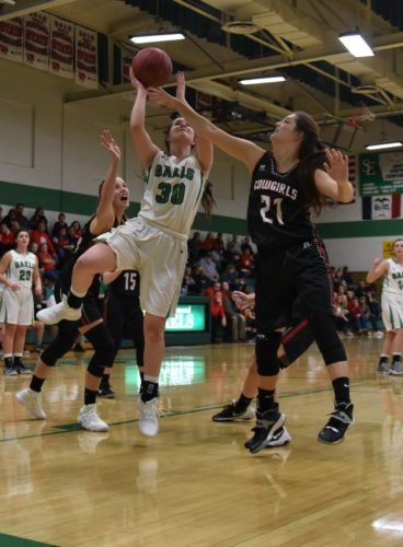 -Messenger photo by Britt Kudla Erin Flattery of St. Edmond shoots around Mariah Frye on Friday