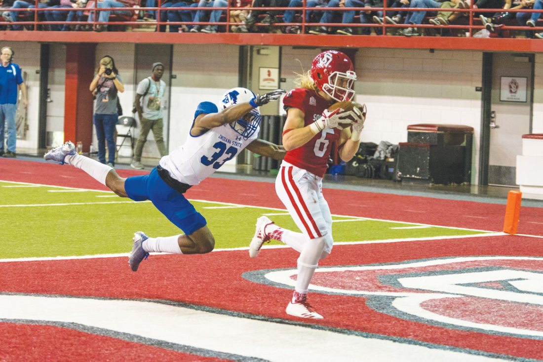 —Photo by Bryan Boettcher South Dakota SID  South Central Calhoun graduate Kody Case catches a touchdown for the South Dakota. Case was named to the Missiouri Valley Football Conference all-newcomer team.