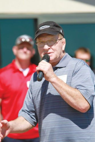 —Submitted photo  Wrestling legend Dan Gable speaks to a crowd last summer. Gable will be in Fort Dodge on Friday for a book signing and autograph session.