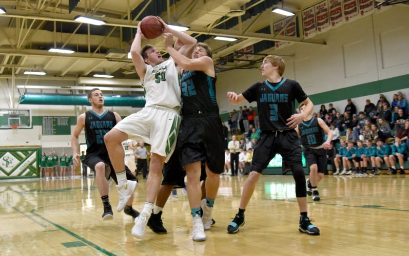 -Messenger photo by Britt Kudla Will Woodruff of St. Edmond shoots over Southeast Valley Tommy Lennon on Tuesday