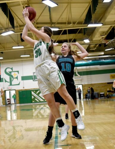 -Messenger photo by Britt Kudla Erin Flattery of St. Edmond shoots around Southeast Valley Mady Jaeschke on Tuesday