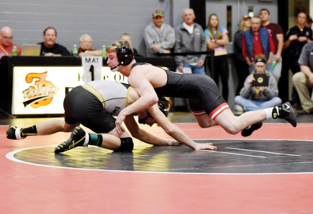 Messenger photo by Britt Kudla  Brody Teske of Fort Dodge wrestles against Emmetsburg's Levi Aldous in the championship round at 126 pounds on Saturday in the Don Miller Invitational. For more photos, please visit CU.messengernews.net