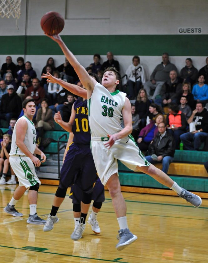 —Photo by Tom Vogt  St. Edmond's Andrew Gibb puts up a shot against Webster CIty in the Gael gym on Tuesday night. Gibb scored 28 points in the win.