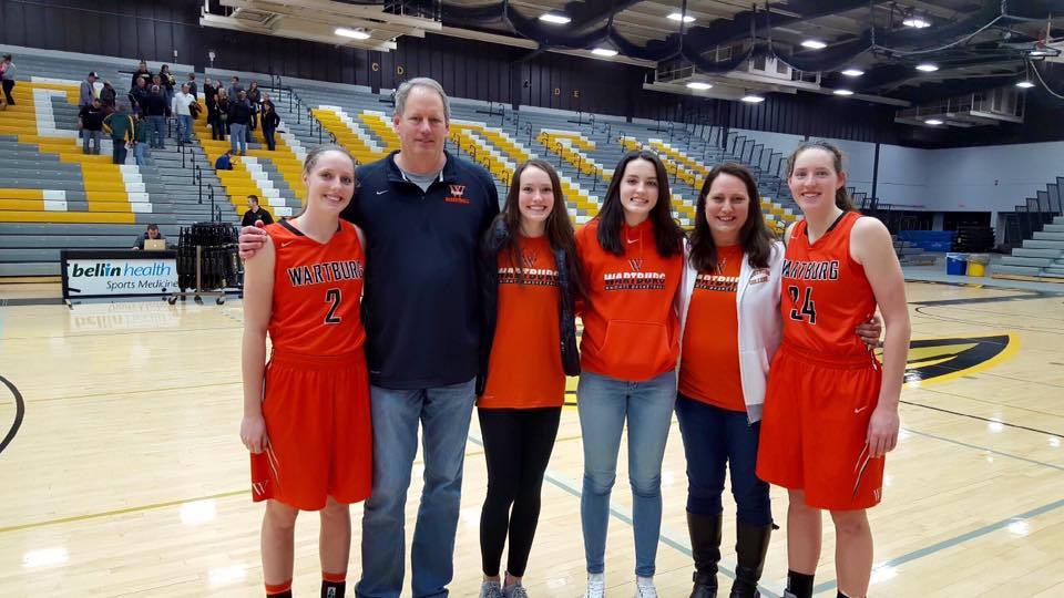 —Submitted photo  Mike Murphy (second from left) and Bonnie (Willard) Murphy (second from right) stand with their daughters Megan, Riley, Jaedon and Miranda following a Wartburg game.