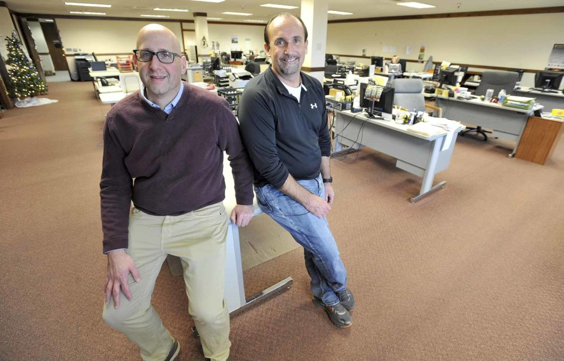 -Messenger photo by Hans Madsen  Former Industry Marketing Solutions owner Steve Scanlan, right, poses in their Boston Center offices with new owner Randy Green who will now call the business RDG Media, Inc.