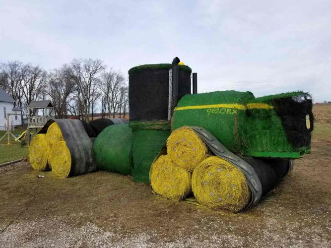 -Messenger photo by Darcy Dougherty Maulsby  The Haselhuhn family has been constructing art from bales of hay for about five years now. This year's masterpiece is a 9260 RX John Deere tractor.