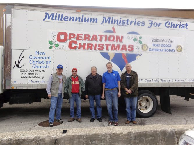Ron Newsome, left, Jeff Becker, Mike Craig, Mark Thompson and Gary Moore made deliveries for Operation Christmas on behalf of Fort Dodge Daybreak Rotary. Boxes of food and home supplies were distributed throughout Fort Dodge.