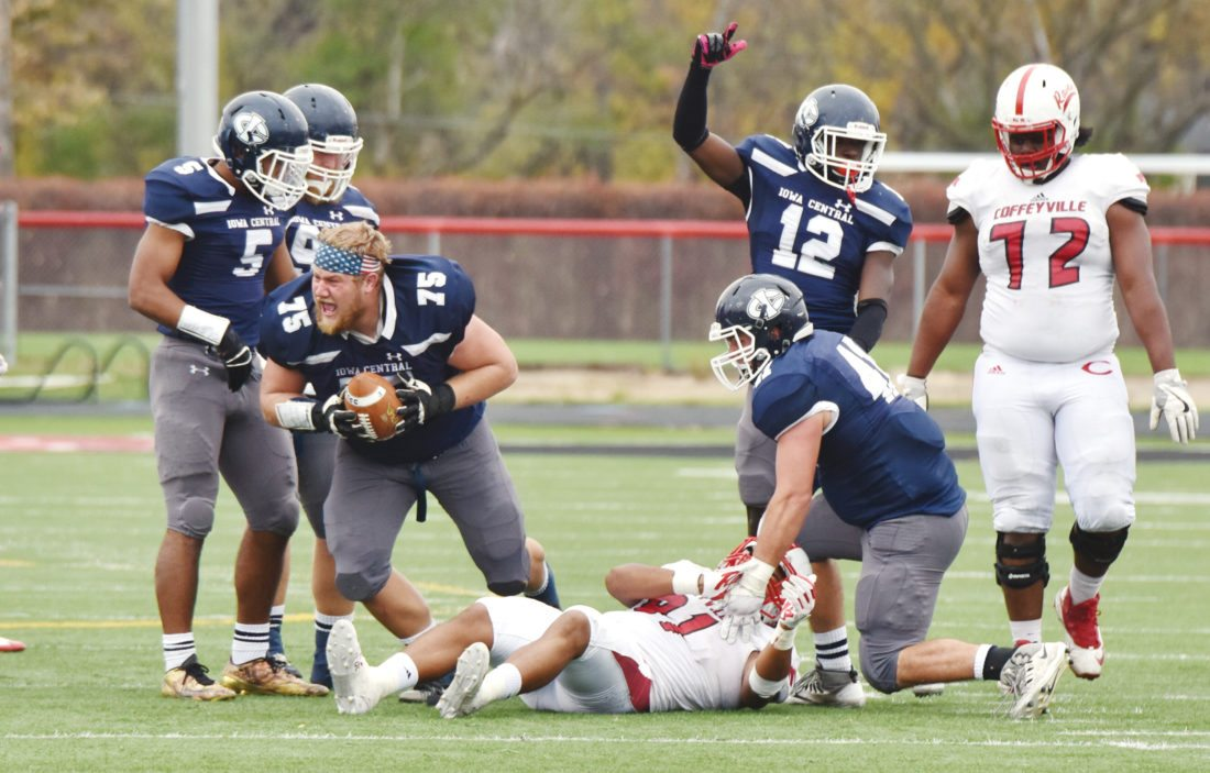 —Photo by Paul DeCoursey  Tim Butcher, a Manson Northwest Webster graduate, recovers a fumble against Coffeyville for Iowa Central. Butcher has signed to play football at Northern Iowa.