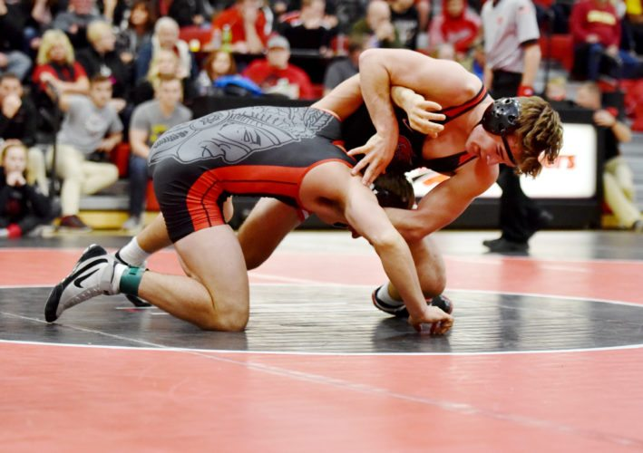 Messenger photo by Britt Kudla  Cayd Lara of Fort Dodge wrestles in the championship round of the Don Miller Invitational earlier this month.