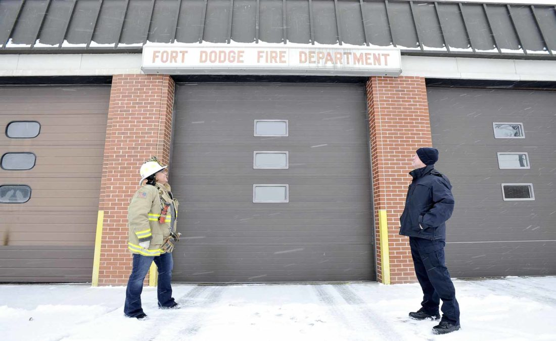 -Messenger photo by Hans Madsen  Greater Fort Dodge Growth Alliance Image Committee member Rhonda Chambers, at left, along with Fort Dodge Fire Chief Steve Hergenreter, look at the old sign on the fire station. The sign, along with a repainting of the doors, are part of a fund raising effort to by the committee to improve the appearance of the building.