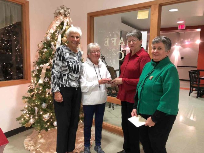 The Fort Dodge Duplicate Bridge Club held its annual Charity Christmas Party Dec. 11 at Citizen's Central. Donations received for the selected charity, Gateway to Discovery, totaled more than $500. Because two anonymous donors have pledged to match all monies up to $20,000 given to Gateway during the months of November and December, the Bridge Club's gift will triple to more than $1,500. Pictured from left are Rose Buda Claussen, Shirley Patterson, Gateway to Discovery board member Joyce Garton-Natte and Carol Deckert.