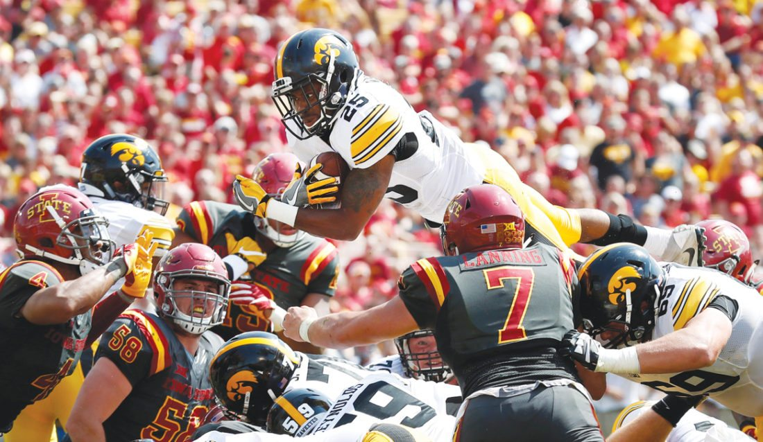 AP Photo  Iowa's Akrum Wadley tries to score against Iowa State during the regular season at Jack Trice Stadium in Ames.