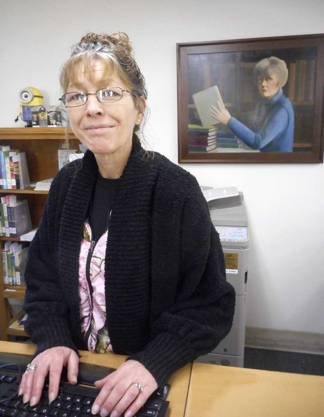 -Messenger photo by Karen Weld   Renee Evje enjoys working with youths at the Eagle Grove Library, a position she has held for nearly 25 years.