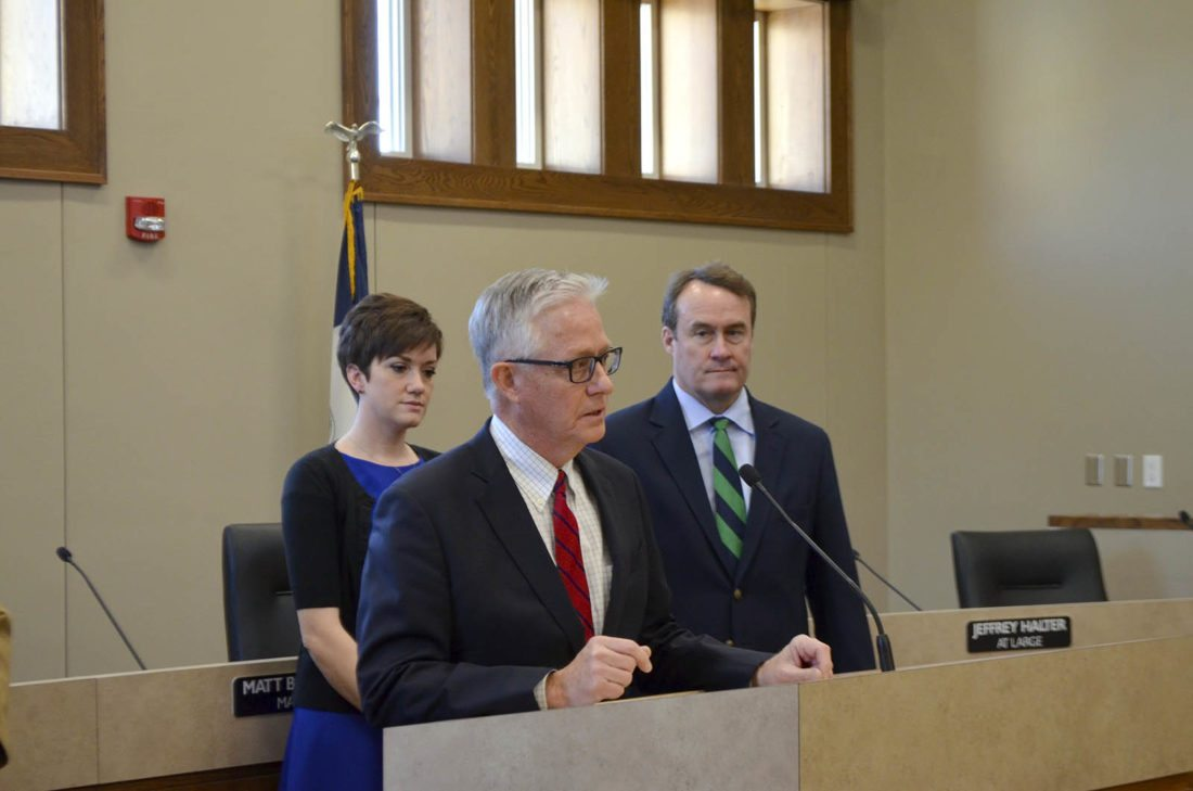 -Messenger photo by Bill Shea  Iowa Supreme Court Chief Justice Mark Cady speaks Tuesday morning before administering the oath of office to members of the Fort Dodge City Council. Newly elected Councilwoman Lydia Schuur and Councilman Dave Flattery listen.