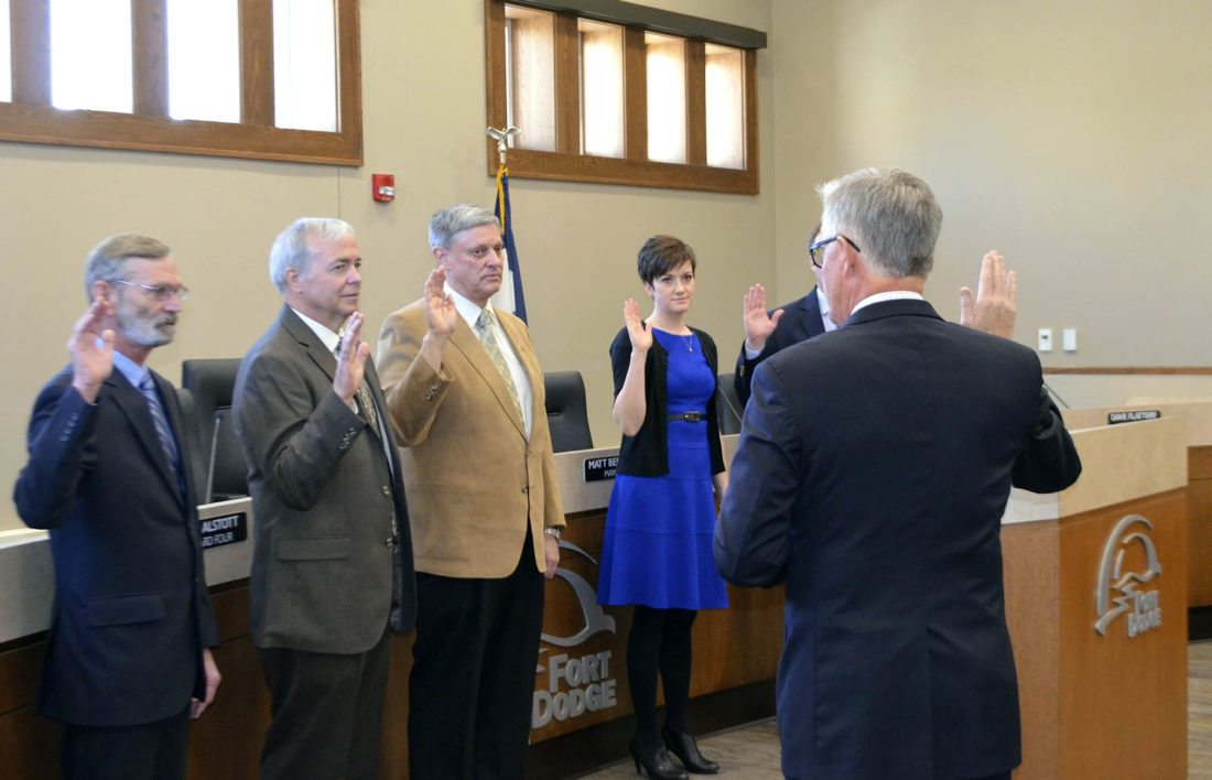 -Messenger photo by Bill Shea   Iowa Supreme Court Chief Justice Mark Cady, right, administers the oath of office to Fort Dodge City Council members, from left, Dean Hill, Terry Moehnke, Kim Alstott and Lydia Schuur Tuesday morning.