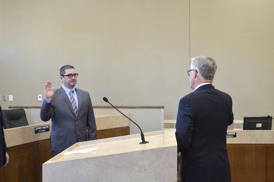 -Messenger photo by Bill Shea Fort Dodge Mayor Matt Bemrich, left, recites the oath of office Tuesday morning for Iowa Supreme Court Chief Justice Mark Cady. Bemrich was re-elected in November for his third four-year term.