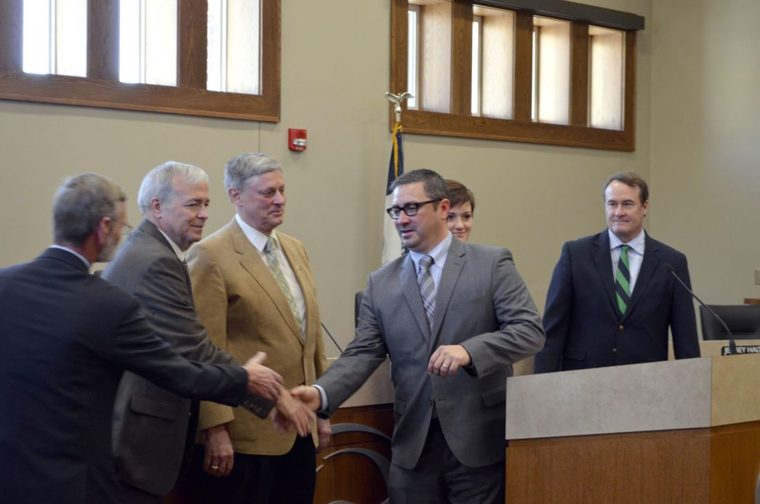 -Messenger photo by Bill Shea  Fort Dodge Mayor Matt Bemrich, center, congratulates members of the City Council Tuesday morning after they took the oath of office. The councilmembers are, from left, Dean Hill, Terry Moehnke, Kim Alstott, Lydia Schuur and Dave Flattery.