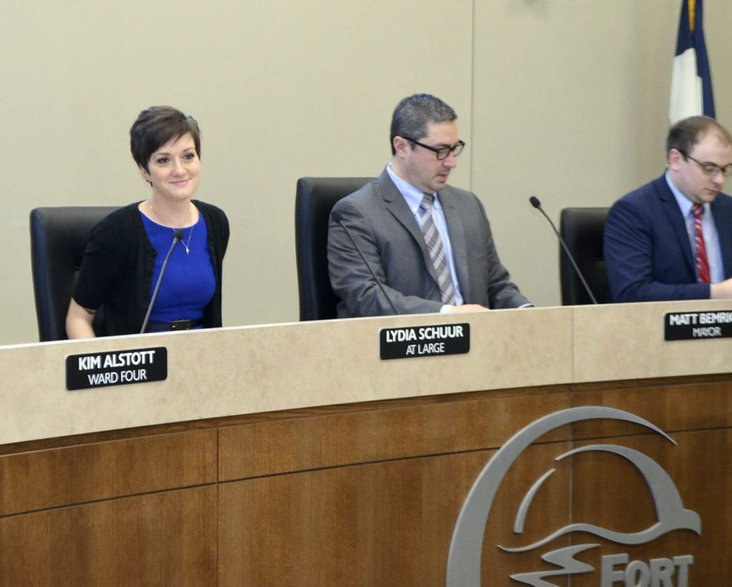 -Messenger photo by Bill Shea    New Fort Dodge City Councilwoman Lydia Schuur takes her place at the council table Tuesday morning. Mayor Matt Bemrich and Councilman Neven Conrad are seated at right.