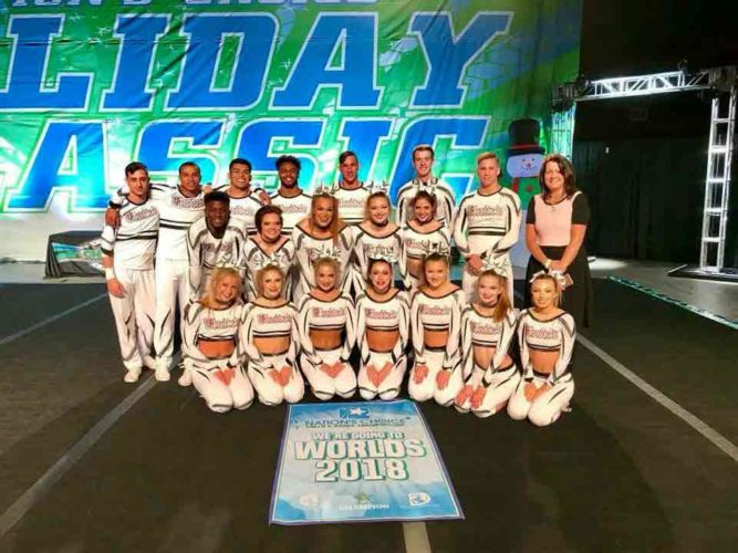 At Nation's Choice Holiday Classic. the Team Eclipse, an International Level 5 Coed team, won their division and earned an At-Large Bid to the Cheerleadiing Worlds competition held at the ESPN Wide World of Sports in Orlando, Florida, April 28 through May 1. The athletes on this team are primarily college age with some high school age athletes.  Pictured from left in the back row are Alex Scherer, Shannn McKennie, Tony Nguyen, Marcus Seay, Weston Crase, Chase Abston, Hunter Fangmann and Coach Mindy DeBaun In the middle row are Kahlil Goodlow, Allison Weisser, Kearsy Lennon, Macy Johnson and Eli Hartzler Pictured in front are Jessica Canny, Xana Simpson, Alanna Schiltz, Jacey DeBaun, Ashley Bouwens, Ayrton Peterson and Amanda Amato.