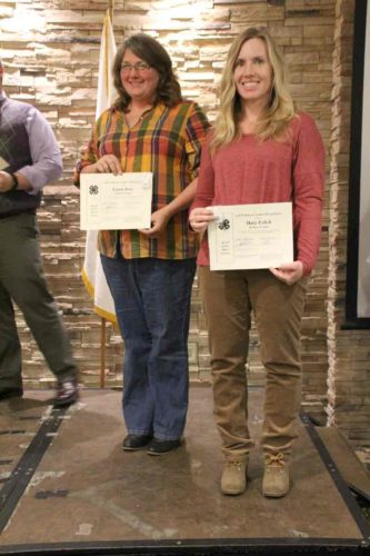 Two 4-H leaders were honored at the 4-H banquet. Pictured are Laura Ross, Gowrie Groundbreakers and poultry project leader for five years, and Mary Eslick, Dayton Tigers Club Leader for five years.