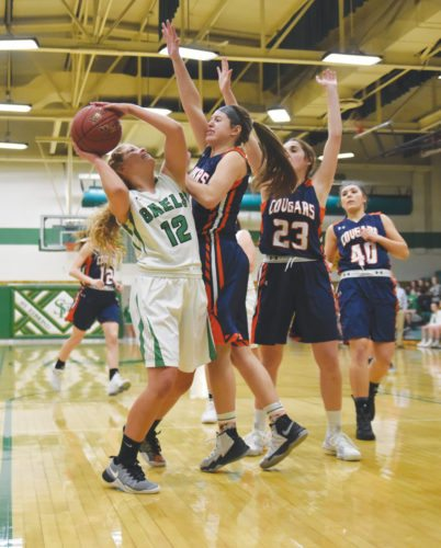 -Messenger photo by Britt Kudla Macey Mason of St. Edmond shoots over Manson NW Webster Bailey Kenyon on Monday