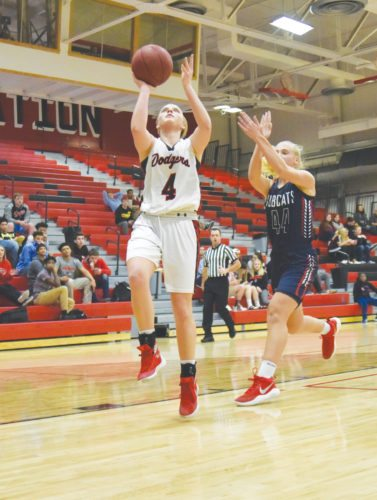 -Messenger photo by Britt Kudla Beth Murman of Fort Dodge shoots around Marshalltown Grace Metzger on Tuesday