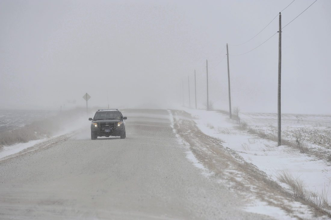 -Messenger photo by Hans Madsen  Dayton Police Chief Nick Dunbar patrols about a mile west of Dayton Thursday afternoon in the near blizzard conditions outside of town.