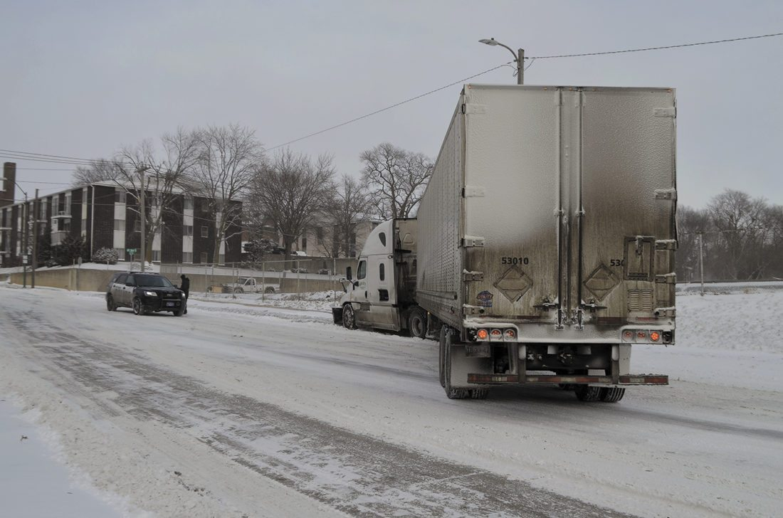 -Messenger photo by Peter Kaspari  A jackknifed semi truck blocks both lanes of South Eighth Street near Kenyon Road Thursday afternoon. It was one of just a handful of accidents the Fort Dodge Police Department responded to Thursday afternoon following snow.