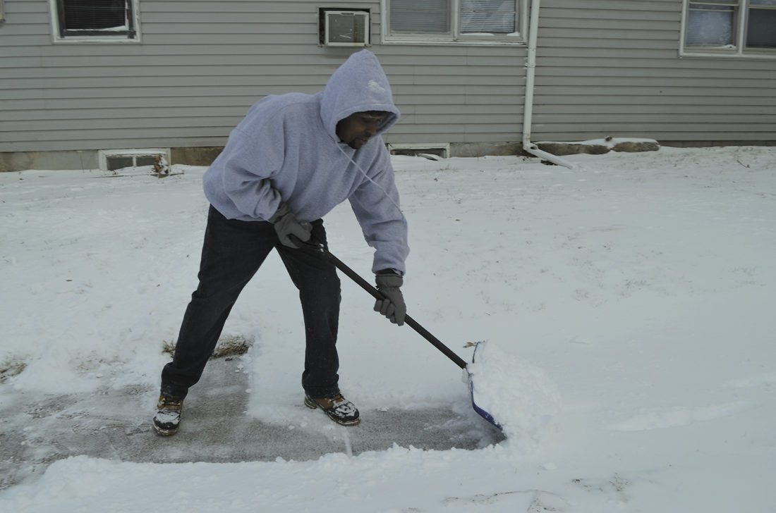 -Messenger photo by Peter Kaspari  Terrance Newsome, of Fort Dodge, removes snow from the sidewalk near the intersection of Sixth Avenue North and Forest Avenue.