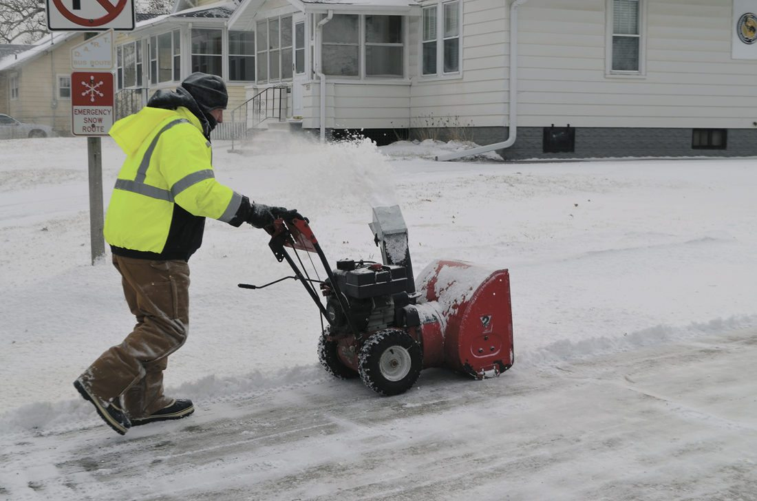 -Messenger photo by Peter Kaspari  Mark Weyant, of Fort Dodge, uses a snow blower to remove snow from his driveway near the intersection of North 22nd Street and Eighth Avenue North Thursday.