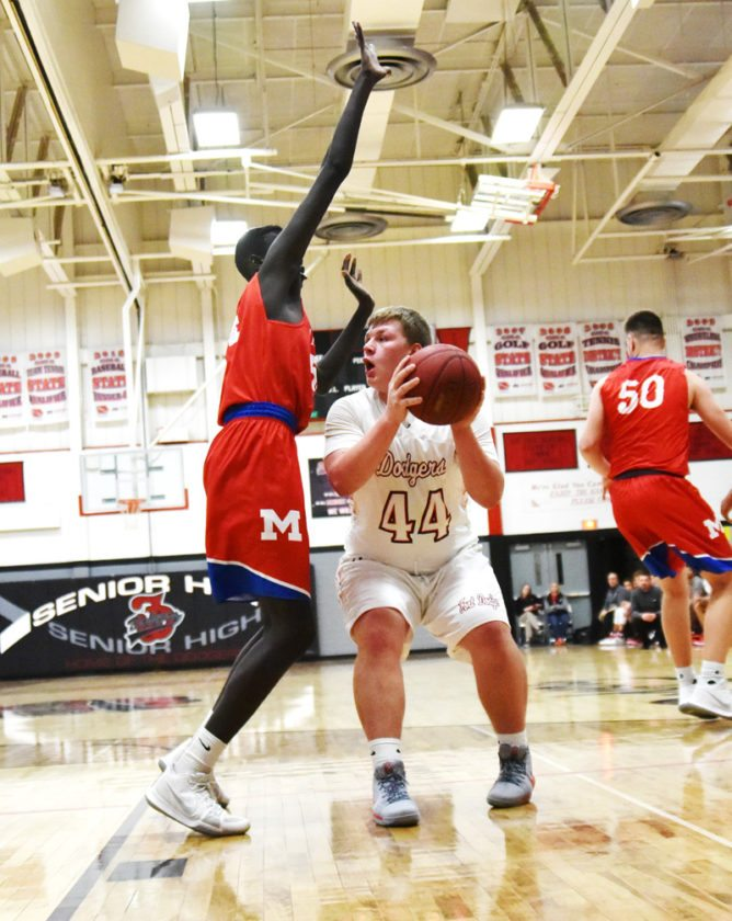 Messenger photo by Britt Kudla  Aaron Porter of Fort Dodge drives earlier this week in the Dodger gym.