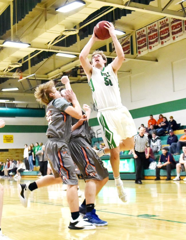 Messenger photo by Britt Kudla  Will Woodruff of St. Edmond shoots against Manson Northwest Webster in the Gael gym earlier this week.