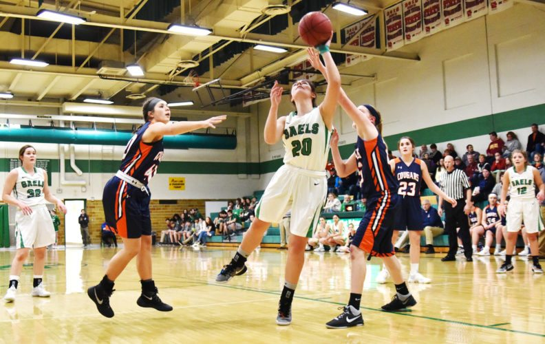 Messenger photo by Britt Kudla  Hannah Huss of St. Edmond drives against Manson Northwest Webster in the Gael gym earlier this week.