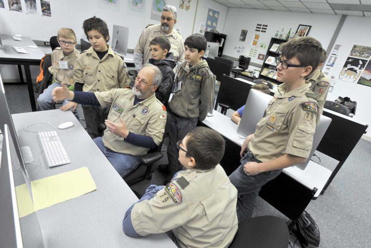 -Messenger photo by Hans Madsen  Boy Scout Troop Leader Doug Breyfogle, with Fort Dodge's Troop 8, introduces a class of Scouts to Adobe InDesign Saturday during a Graphic Arts Merit Badge class at the annual Twin Lakes District Merit Badge College on the Iowa Central Community College campus.