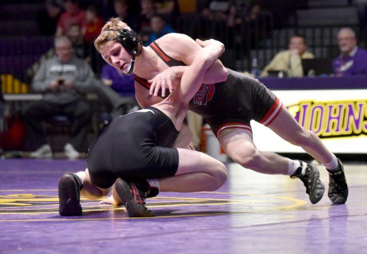-Messenger photo by Britt Kudla Brody Teske of Fort Dodge wrestles against Johnston James Edwards on Thursday