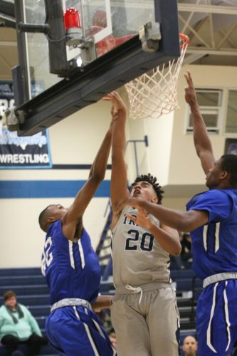 —Photo by Paul DeCoursey  Iowa Central's Dallas Bailey puts up a shot under the basket against Kirkwood on Saturday.