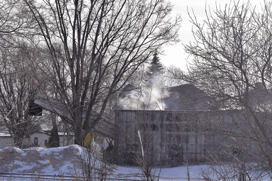 -Messenger photo by Peter Kaspari  Smoke rises from a building on the property of the Was Broken Pallet Co. Monday, hours after a fire was reported at the building. The fire was believed to have been started by a piece of equipment.