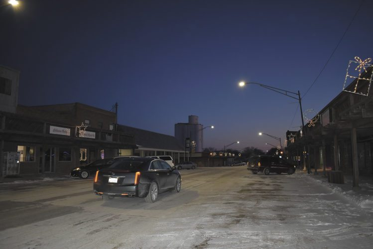 -Messenger photo by Chad Thompson  A car moves along Main Street in Manson Tuesday night. Two blocks of road on Main Street from Ninth Avenue to 11th Avenue are to be repaved this summer.