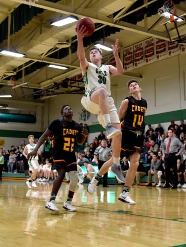 -Messenger photo by Britt Kudla Andrew Gibb of St. Edmond drives towards the basket against Iowa Falls-Alden on Friday