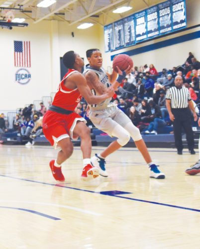 -Messenger photo by Britt Kudla Tray Croft of Iowa Central drives towards the basket against Southwestern on Wednesday