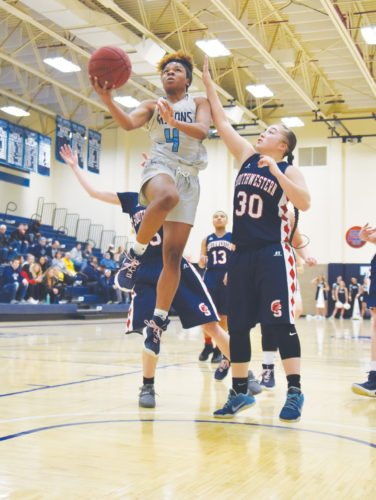 -Messenger photo by Britt Kudla Mardaeja Cross of Iowa Central shoots around Southwestern Vanessa Romo on Wednesday